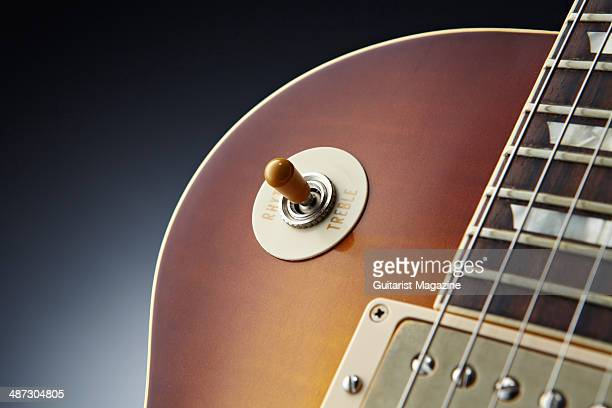 Detail of the Rhythm/Treble switch on a 2013 Gibson Custom 1959 Les Paul Standard Reissue electric guitar taken on August 5 2013