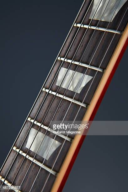Detail of the rosewood fingerboard on a 2013 Gibson Custom 1959 Les Paul Standard Reissue electric guitar taken on August 5 2013