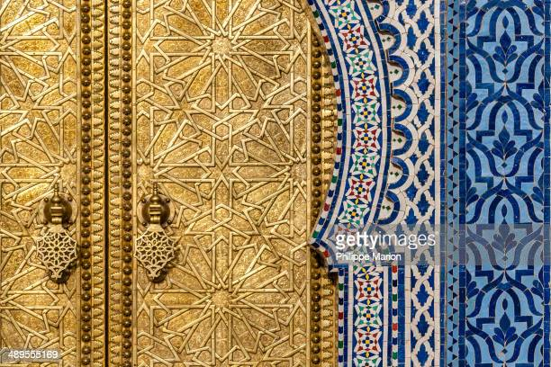 Detail of the shiny brass door of the Royal Palace in Fez. Morocco. The Palace is closed for visitors but its huge brass doors are a sight by...