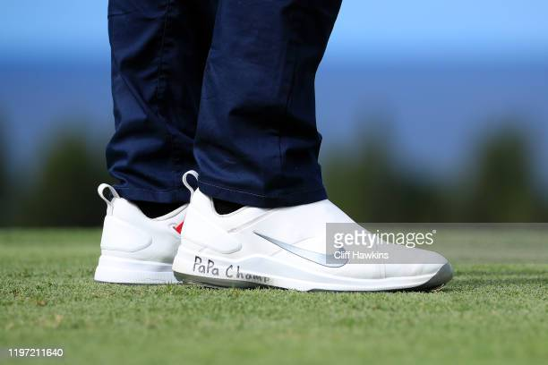 A detail of the shoes of Cameron Champ of the United States with PaPa Champ written on them during the first round of the Sentry Tournament Of...
