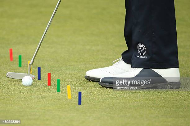 Detail of the shoes of Ian Poulter of England on the putting green ahead of the 144th Open Championship at The Old Course on July 13 2015 in St...