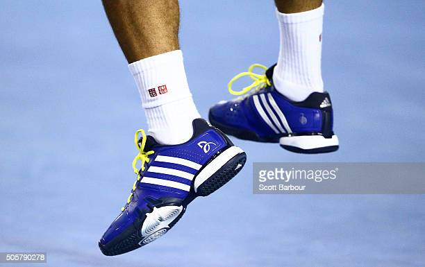 A detail of the shoes of Novak Djokovic of Serbia as he serves his second round match against Quentin Halys of France during day three of the 2016...