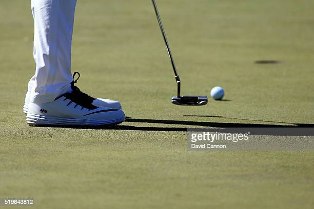 A detail of the shoes of Rory McIlroy of Northern Ireland as he putts for birdie on the seventh green during the first round of the 2016 Masters...