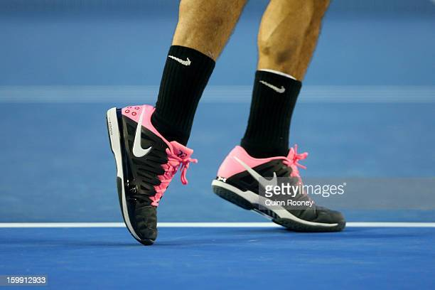 Detail of the shoes on Roger Federer of Switzerland as he serves in his Quarterfinal match against JoWilfred Tsonga of France during day ten of the...
