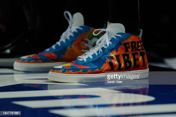 """Detail of the shoes worn by Enes Kanter of the Boston Celtics with the wording """"Free Tibet"""" during the first half against the New York Knicks at..."""