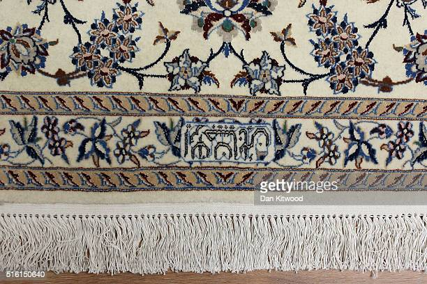 A detail of the signature of the founder of a 'Nain' Persian rug at the Oriental Rug Centre's main warehouse on March 17 2016 in London England The...