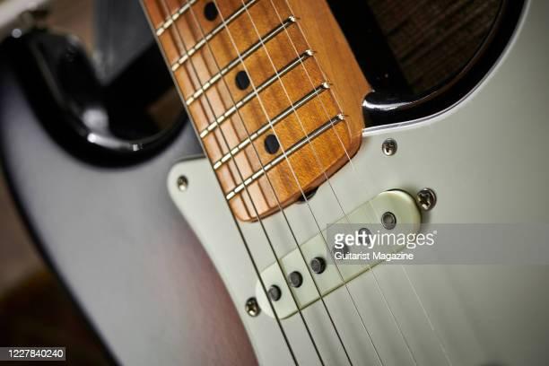 Detail of the single-coil pickups on a Fender Custom Shop Vintage Custom 62 Stratocaster electric guitar with a 3-Color Sunburst finish, taken on...
