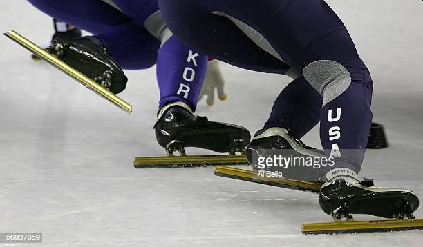 A detail of the skates of HyoJung Kim of the United States and EunKyung Choi of Korea is seen as they skate on the final day of the women's 1000...