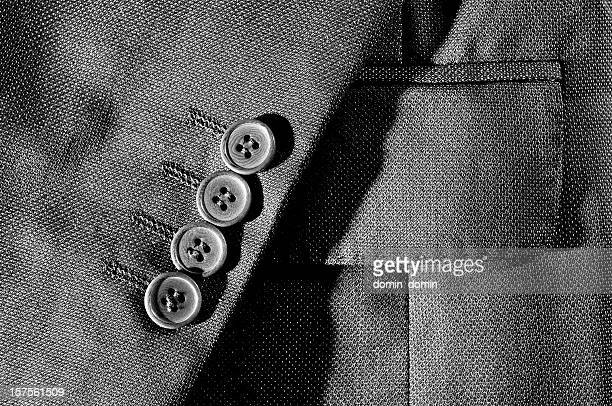 Detail of the sleeve suit, buttons, pocket, black and white