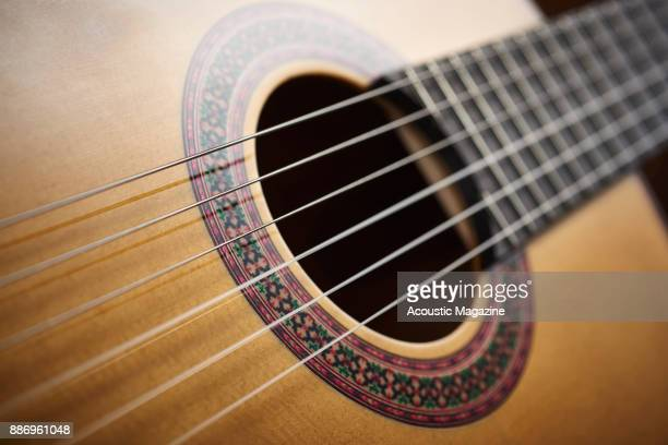 Detail of the sound hole and rosette on a Manuel Rodriguez Model FF flamenco classical guitar taken on February 3 2017