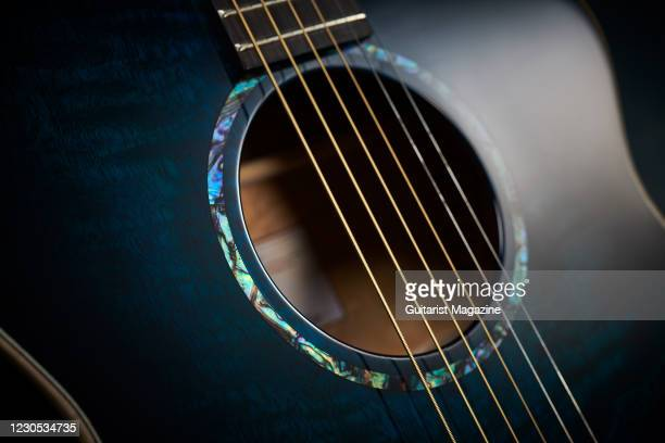 Detail of the sound hole on a Faith Neptune Blue Moon electro-acoustic guitar with a Blue Burst finish, taken on January 2, 2020.