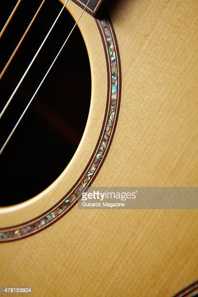 Detail of the sound hole purfling on an Avalon Ard Ri A3335FC acoustic guitar taken on November 11 2014