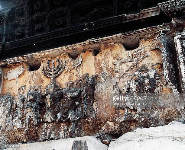Detail of the spoils of war the sevenbranched candelabrum and silver tube reliefs from the Arch of Titus built to commemorate the conquest of...