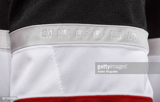 A detail of the Stanley Cup winning years woven into the sleeves of the Ottawa Senators 100 Classic jerseys prior to a game against the Tampa Bay...