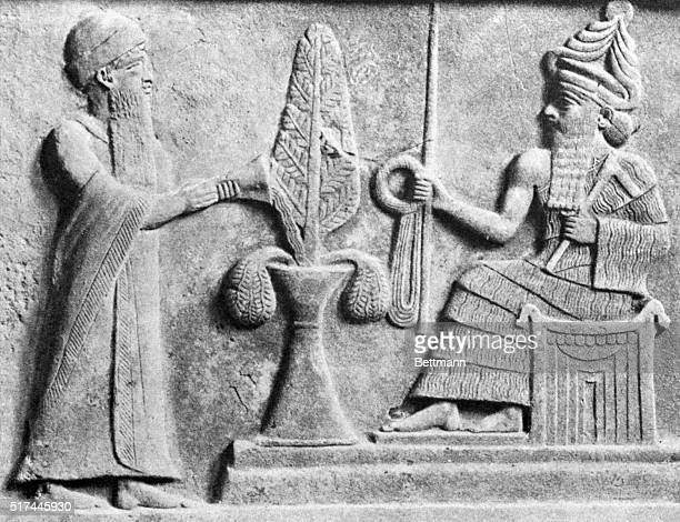 A detail of the Stele of UrNammu showing King UrNammu making an offering to the moon god Nannar The stele dates to ca 2060 BC