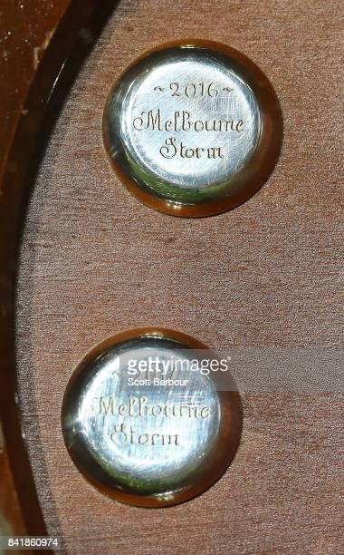 A detail of the Storm 2016 and 2017 badges on the JJ Giltinan Shield as minor premiers after winning the round 26 NRL match between the Melbourne...