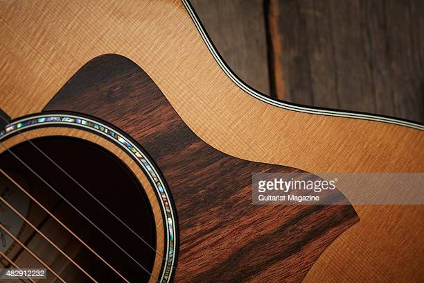 Detail Of The Striped Ebony Pickguard On A Taylor 2015 618e Grand Orchestra Electroacoustic Guitar Taken