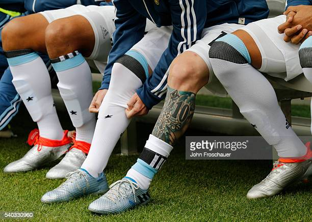 Detail of the tattoo and boots of Lionel Messi of Argentina during a group D match between Argentina and Bolivia at CenturyLink Field as part of Copa...