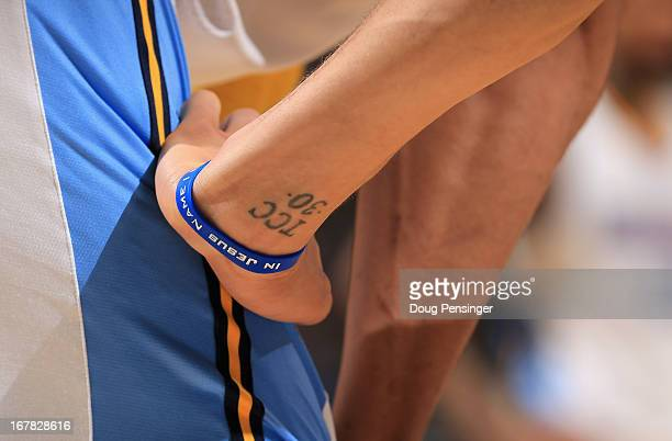A detail of the tattoo and wrist band of Stephen Curry of the Golden State Warriors as he plays against the Denver Nuggets during Game Five of the...