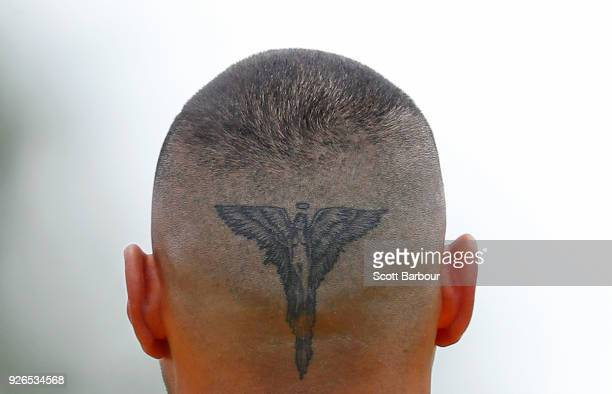 A detail of the tattoo on the back of the head of Jarman Impey of the Hawks during the AFL JLT Community Series match between the Western Bulldogs...