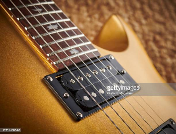 Detail of the TCI Treble and Bass humbuckers on a PRS SE Santana Singlecut Trem electric guitar with an Egyptian Gold finish, taken on October 29,...