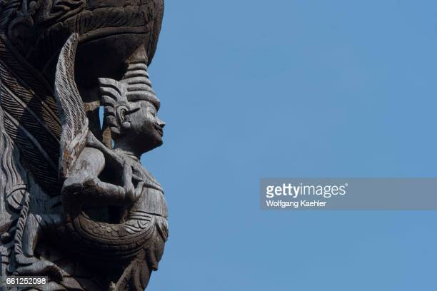 Detail of the teak carvings of Buddhist myths at the Shwenandaw Monastery in Mandalay Hill which was built in 1880 by King Thibaw Min with originally...