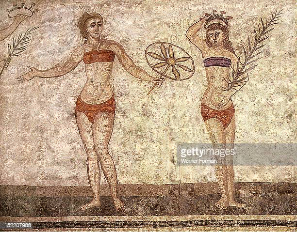 Detail of the Ten Girls Mosaic depicting women athletes Girl holding a chariots wheel and to her left the winner of the competition is standing with...