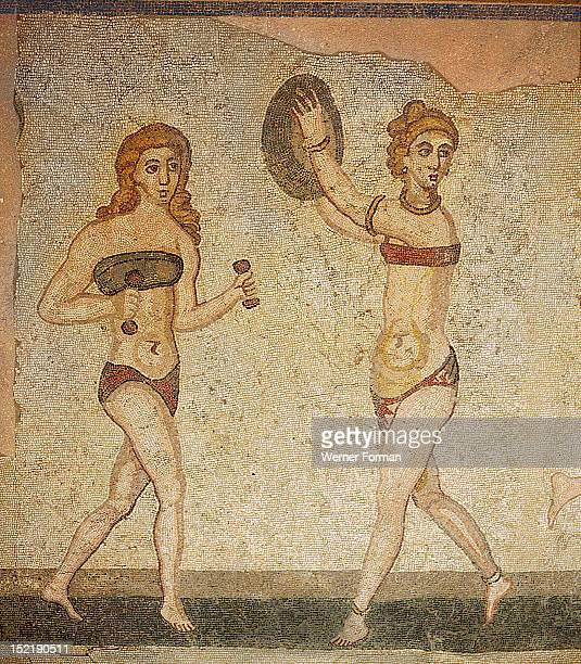 Detail of the Ten Girls Mosaic depicting women athletes Girl with hand weights and girl with discus From the Villa of Casale Piazza Armerina Sicily...