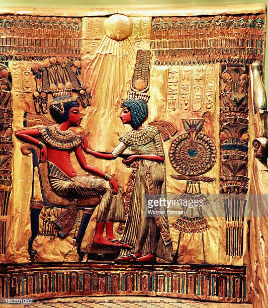 Detail of the throne of Tutankhamun Queen Ankhesenamun holds a salve cup and spreads perfumed oil on her husbands collar in a typical Amarna style...