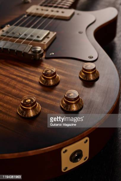 Detail of the tone and volume controls on a Patrick James Eggle Macon Special electric guitar with a Faded Tobacco Burst finish taken on April 5 2019