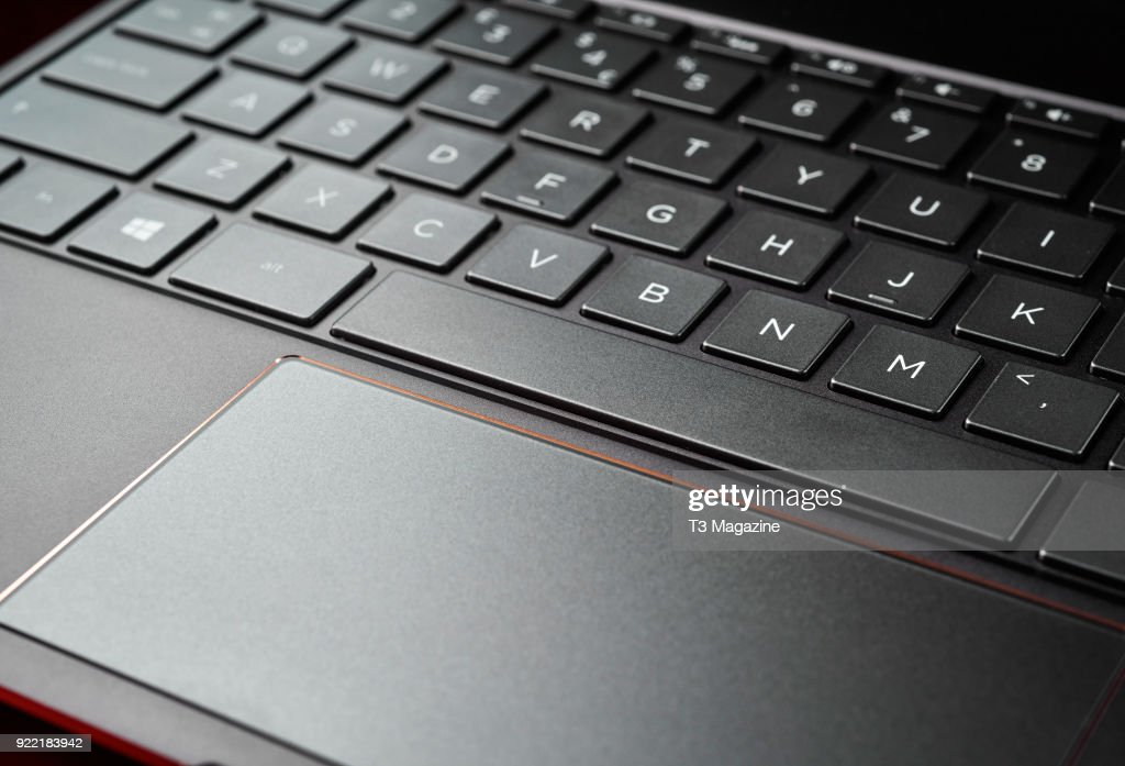 Detail of the trackpad and keyboard on an HP Spectre x360 13-ac011na laptop, taken on July 7, 2017.