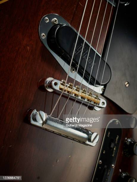 Detail of the tuneomatic bridge and stop tailpiece on a vintage 1969 Gibson Les Paul Professional electric guitar with a transparent Walnut finish...