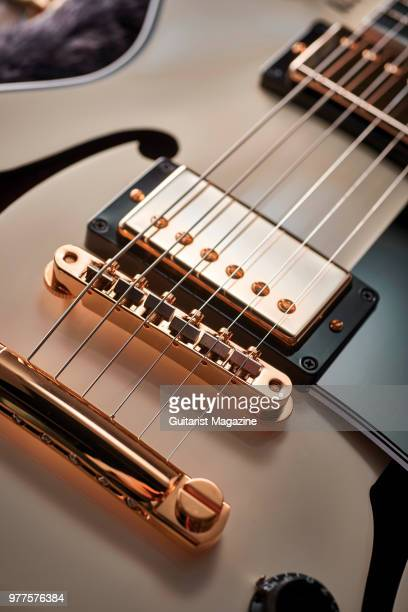 Detail of the Tuneomatic bridge stud tailpiece and MHS Alnico II humbucker on a Gibson Alex Lifeson ESLes Paul electric guitar with a Classic White...