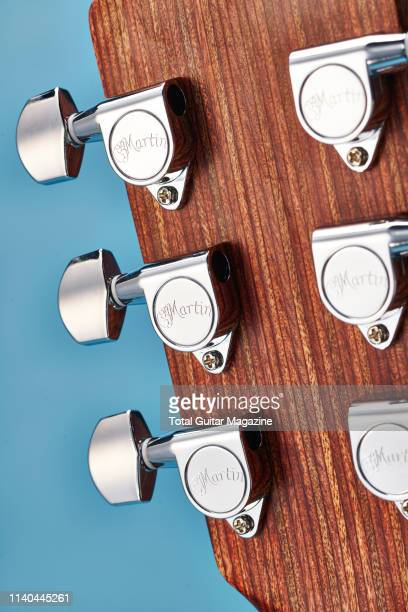 Detail of the tuners on the headstock of a Martin LX1E electroacoustic guitar taken on March 16 2018