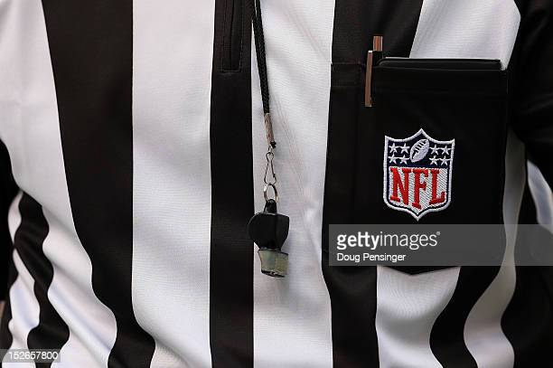 A detail of the uniform and whistle of an NFL referee as he oversees the action between the Houston Texans and the Denver Broncos at Sports Authority...