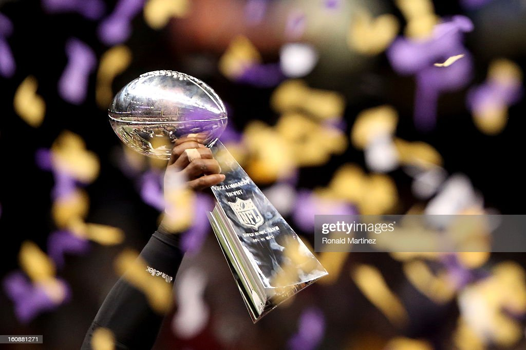 A detail of the Vince Lombardi Championship trophy held up by a player from the Baltimore Ravens as confetti falls after the Ravens won 34-31 against the San Francisco 49ers during Super Bowl XLVII at the Mercedes-Benz Superdome on February 3, 2013 in New Orleans, Louisiana.