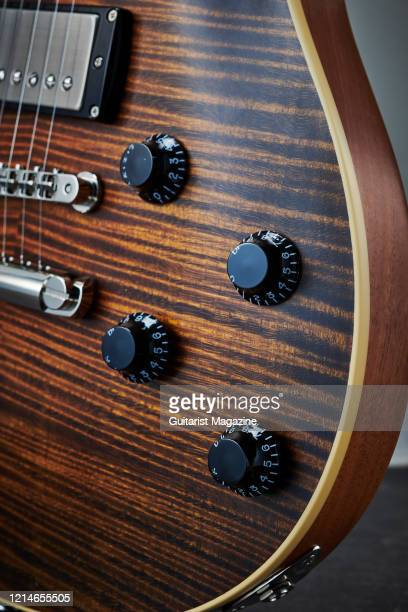 Detail of the volume and tone controls on a Seth Baccus Nautilus Classic electric guitar with a DoubleStained Whiskey Burst finish taken on June 18...