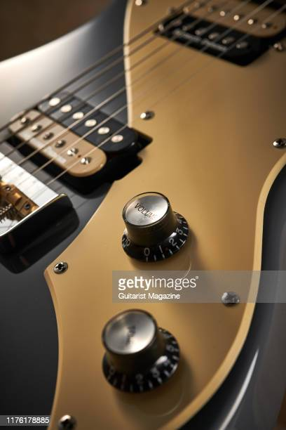 Detail of the volume and tone controls on a Shergold Provocateur SP02SD electric guitar with a Battleship Grey finish taken on February 8 2019