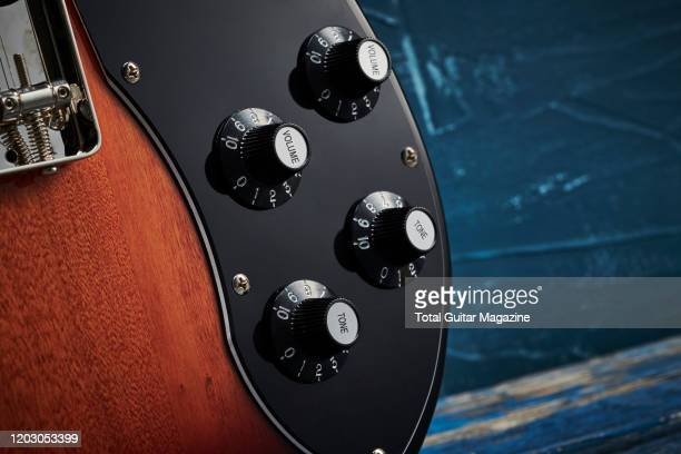 Detail of the volume and tone controls on a Squier Classic Vibe 70s Telecaster Custom electric guitar with a 3-Colour Sunburst finish, taken on July...