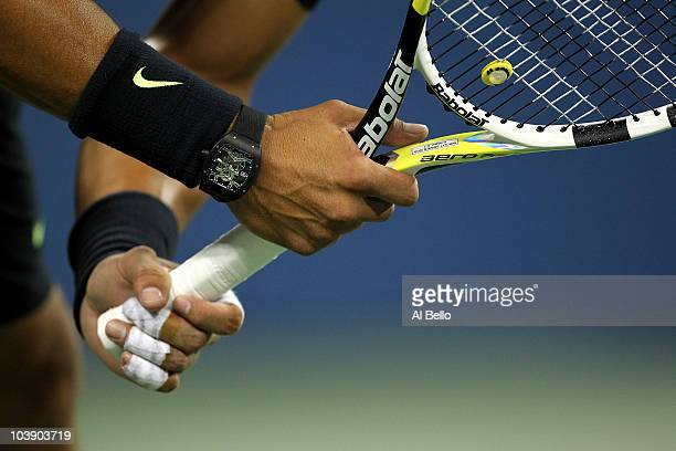 A detail of the watch worn by Rafael Nadal of Spain as he awaits a serve from Feliciano Lopez of Spain during his men's singles match on day nine of...