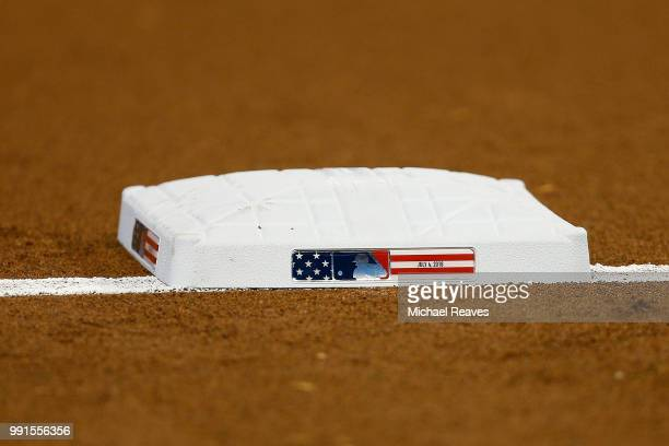 A detail of third base with Independence Day themed logo prior to the game between the Miami Marlins and the Tampa Bay Rays at Marlins Park on July 4...