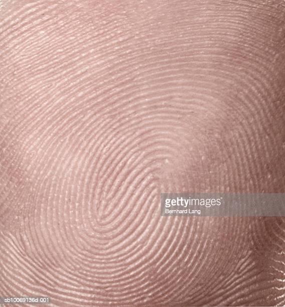 detail of thumbprint (digital composite) - menschliche haut stock-fotos und bilder