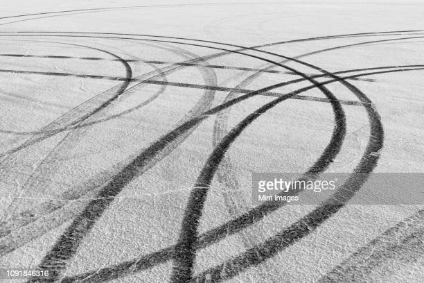 detail of tire tracks on salt flats - track imprint stock photos and pictures