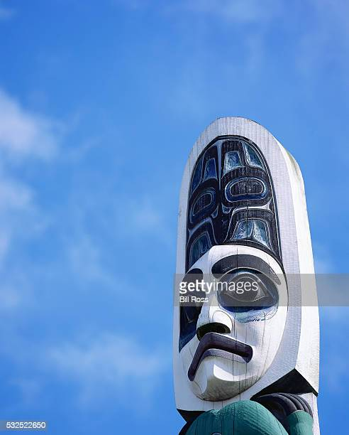 detail of tlingit totem pole with face - totem pole stock pictures, royalty-free photos & images