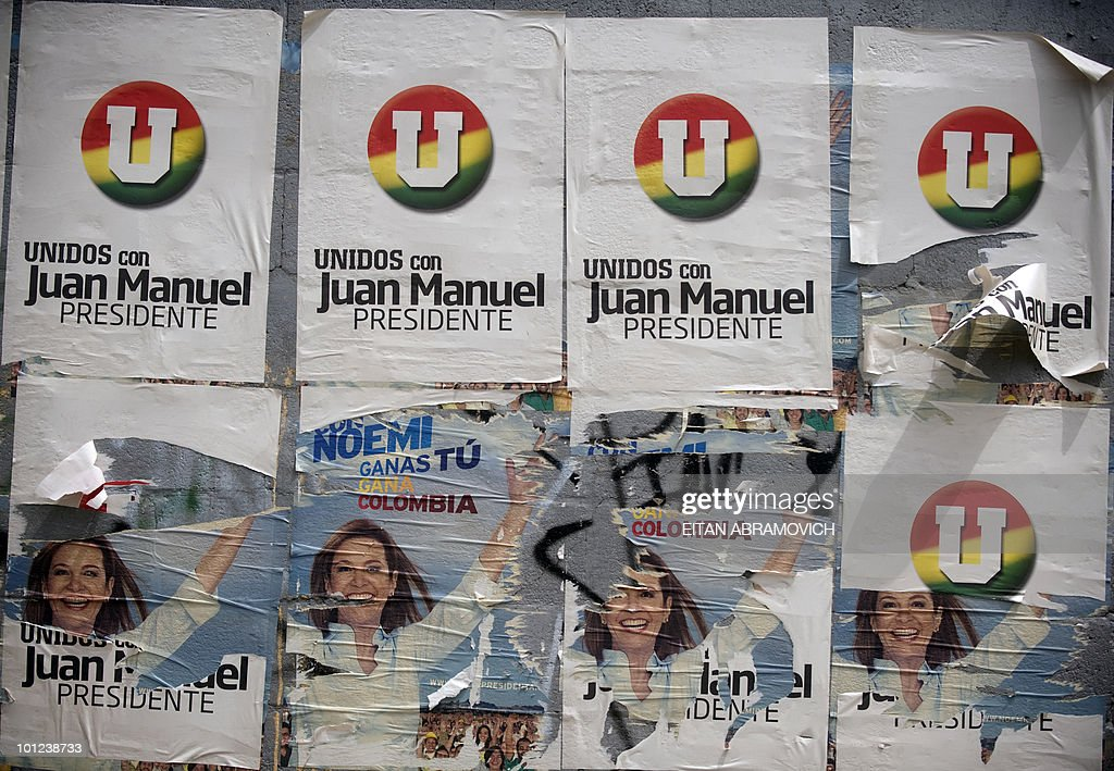 Detail of torn propaganda posters of Colombian presidential candidate for the ruling National Unity Party, Juan Manuel Santos, on top of the ones of the presidential candidate for the Conservative Party, Noemi Santos, pasted on a wall in the outskirts of Bogota on May 28, 2010. Colombia will hold presidential elections next May 30, and according to polls, a run-off election between Santos and the presidential candidate for the Green Party, Antanas Mockus, will take place on June 20. AFP PHOTO/Eitan Abramovich