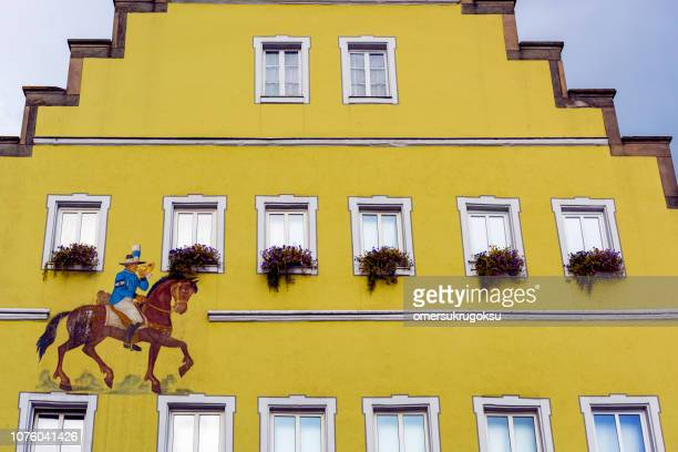 Detail of traditional architecture and wall painting (horse) in Feuchtwangen town, Germany