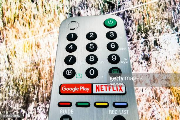 Detail of TV remote control with streaming platform buttons is seen in a store inside Galeria Krakowska shopping mall in Krakow, Poland on May 4,...