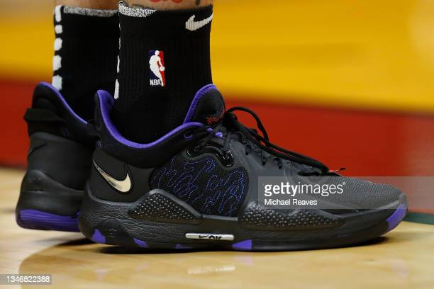 Detail of Tyler Herro of the Miami Heat Nike shoes against the Boston Celtics during the first quarter of a preseason game at FTX Arena on October...