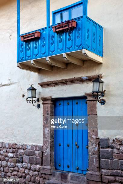 Detail of vibrant blue doors and balcony in historic Cusco city, Peru