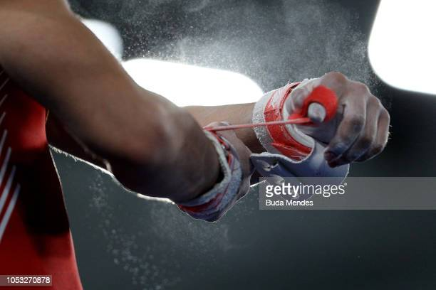 Detail of Victor Betancourt of Venezuela as he gets ready to compete in Men's Horizontal Bar Qualification during Day 4 of Buenos Aires 2018 Youth...